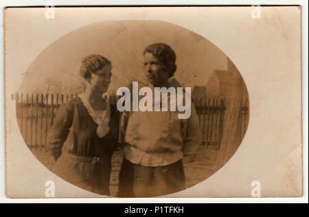 AUSTRIA-HUNGARY - CIRCA 1915: Vintage photo shows two women - mother and daughter. Retro black & white photography with sepia effect. Photo was taken in Austro-Hungarian Empire or also Austro-Hungarian Monarchy - Stock Photo