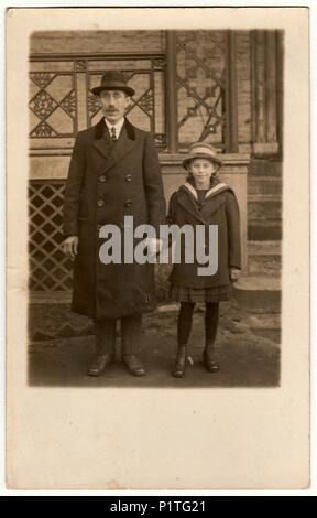 THE CZECHOSLOVAK REPUBLIC - CIRCA 1930s: Vintage photo shows father with daughter pose outdoors. Retro black & white photography. - Stock Photo