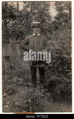 RIO DE JANEIRO, BRAZIL - OCTOBER 31, 1912: Vintage photo shows man wears straw boater hat. Retro black & white photography. - Stock Photo