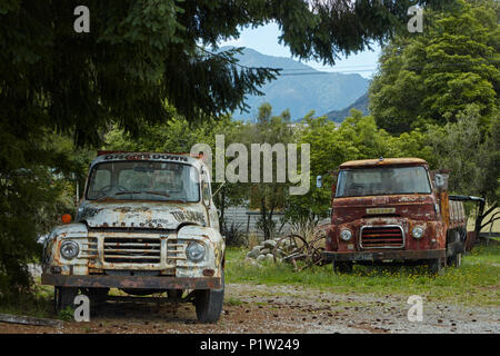 Old Bedford and Morris trucks, Murchison, Tasman District, South Island, New Zealand - Stock Photo