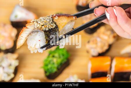 Japanese food, sticks keep sushi with eel - Stock Photo