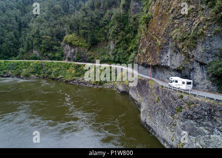 Campervan at Hawks Crag, and Buller River, Buller Gorge, State Highway 6 near Westport, West Coast, South Island, New Zealand - drone aerial - Stock Photo