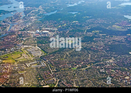 STOCKHOLM, SWEDEN - JUNE 1, 2018: Aerial shot over Stockholm with landmarks Stockholm Globe and Tele2 Arena during inflight to Arlanda airport on a su - Stock Photo