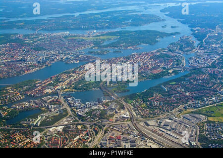 STOCKHOLM, SWEDEN - JUNE 1, 2018: Aerial shot over Stockholm, Sodermalm, Old Town island and Djurgarden, during inflight to Arlanda airport on a sunny - Stock Photo