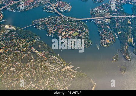 STOCKHOLM, SWEDEN - JUNE 1, 2018: Aerial shot over Stockholm, Essingeleden and Traneberg bridge to Bromma, during inflight to Arlanda airport on a sun - Stock Photo