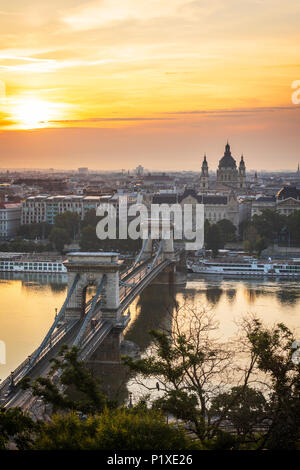 Sunrise in Budapest over Basilica St Stephen - Stock Photo