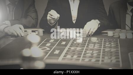 People playing in casino - Stock Photo