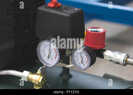 Two manometers on industrial device in factory - Stock Photo