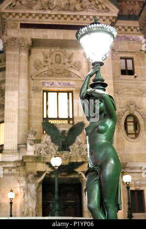 Paris, 9th arrondissement, night Palais Garnier. Sculpture and streetlight side facade. - Stock Photo