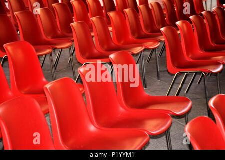Red armchairs in a row for musical performance. - Stock Photo
