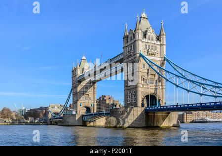 Tower Bridge against the winter blue sky. The bascule and suspension bridge crosses the River Thames and has become an iconic symbol of London. - Stock Photo