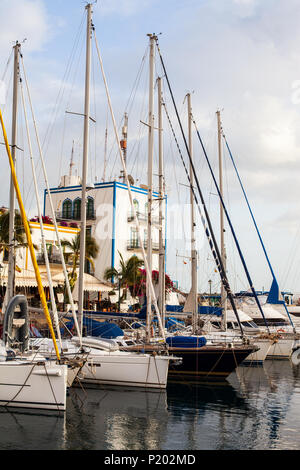 Sailboats and yachts in harbor in Puerto de Mogan, Gran Canaria, Spain. Summer holidays concept. Canary Islands - Stock Photo