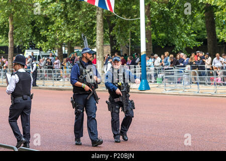 Armed Police officers of The Specialist Firearms Command SCO19  patrolling the crowds at The Trooping Of The Colour Ceremony, The Mall ,London 2018 - Stock Photo