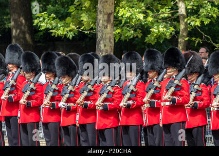 Soldiers of The Irish Guards marching along the Mall at The Trooping Of The Colour / Queen's Birthday parade 2018 - Stock Photo