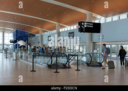 Tampa International Airport, Florida USA. 2018. Passengers wait in the Main Terminal Station for a train to Economy parking and the car rental center. - Stock Photo