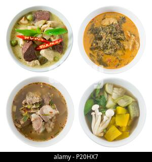 Thai Cuisine and Food, Top View of Green Curry with Green Eggplant, Red Curry with Cassia Leaves, Clear Spicy Hot and Sour Soup and Mixed Vegetables S - Stock Photo