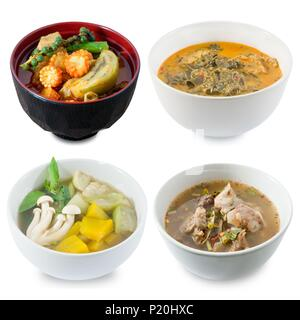 Thai Cuisine and Food, Top View of Red Curry with Green Eggplant, Coconut Milk with Cassia Leaves, Clear Spicy Hot and Sour Soup and Mixed Vegetables  - Stock Photo