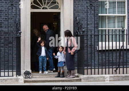 London, UK. 12th June, 2018. Children and parents arrive at 10 Downing Street where Prime Minister Theresa May hosted a garden planting event for children affected by the Grenfell fire. - Stock Photo