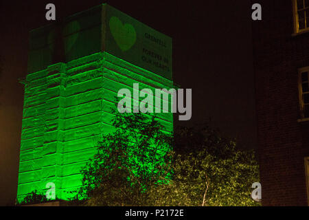 London, UK. 14th June, 2018. The Green for Grenfell illuminations are lit at the Grenfell Tower and the twelve closest tower blocks on the first anniversary of the fire in a display intended to 'shine a light' of love and solidarity for all those affected and to raise awareness of the plight of those still without new homes after one year. Green for Grenfell is a community-led initiative in collaboration with tenants' and residents' associations and Grenfell United. Credit: Mark Kerrison/Alamy Live News - Stock Photo