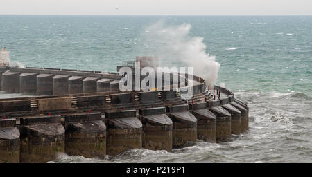 Brighton UK 14th June 2018 - Waves crash over Brighton Marina wall as Storm Hector sweeps across Britain with high winds and rain causing travel problems and damage in some parts of the country Credit: Simon Dack/Alamy Live News - Stock Photo