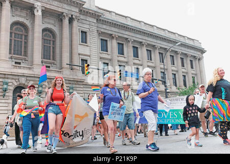 Participants in the 2018 Pride March in Cleveland, Ohio, USA make their way past the historic City Hall and Courthouse in downtown Cleveland. - Stock Photo