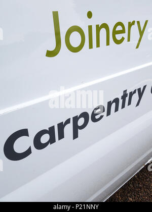 Carpentry and Joinery sign writing on a Professional trades van - Stock Photo