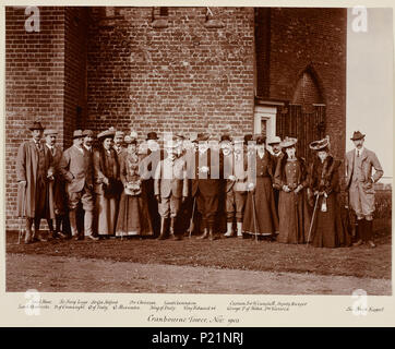 . English: Photograph of a group standing outside Cranbourne Tower. Included within the group are King Edward VII (1841-1910) in the centre, facing the viewer. On his right stands King Vittorio Emmanuele III (1869-1947), King of Italy and Prince George of York, later King George V (1865-1936). Queen Elena of Italy (1873-1952) stands alongside the Duke of Connaught (1850-1942). November 1903. Unknown Person 167 King Edward VII with the King and Queen of Italy - Stock Photo