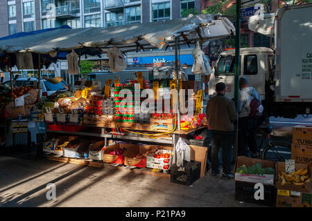 A fruit and vegetable vendor in the Chelsea neighborhood of New York on Tuesday, June 12, 2018.  (© Richard B. Levine) - Stock Photo