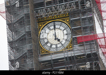Scaffolding surrounds the clock face of Big Ben Elizabeth Tower Palace of Westminster Houses of Parliament during restorations renovations repairs and - Stock Photo