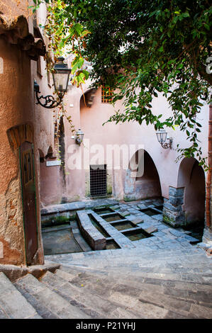 The historic Medieval lavatoio (lavatory) of the Sicilian town of Cefalu. Here, the women used to wash the clothes of the family. Sicily, Italy. - Stock Photo
