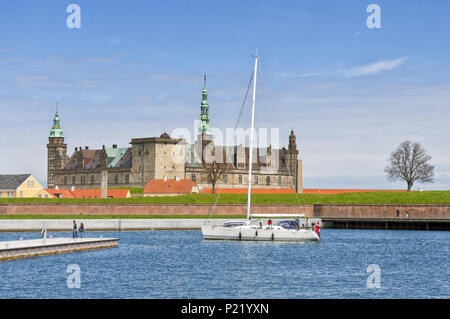 A view of Kronborg castle, the famous Hamlet's Castle with the sea and a boat in Helsingor, (Elsinore) Denmark, Europe. Shakespeare Places. - Stock Photo
