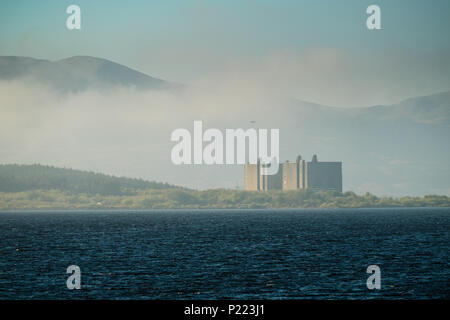 Trawsfynydd lake and the looming bulk of the decomissioned nuclear power station, Snowdonia National Park,Gwynedd, North Wales UK - Stock Photo