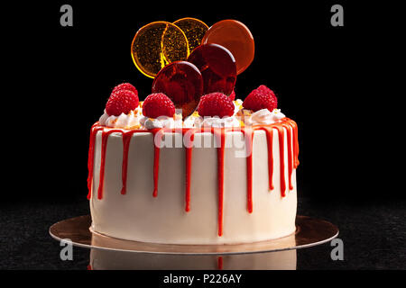 Raspberry cream mousse cake no baked cheesecake on black background - Stock Photo
