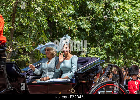 Duchess Of Cambridge,Kate Middleton & Duchess Of Cornwall,Camilla,ride together in a carriage, wave to the crowds at The Trooping Of The Colour 2018 - Stock Photo