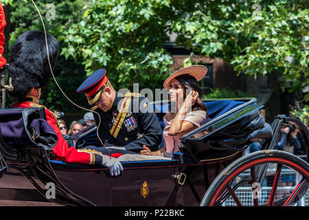 Prince Harry ,Duke of Sussex riding along The Mall in a carriage with Meghan Markle ,The Duchess Of Sussex ,at The Trooping Of The Colour  London,2018 - Stock Photo