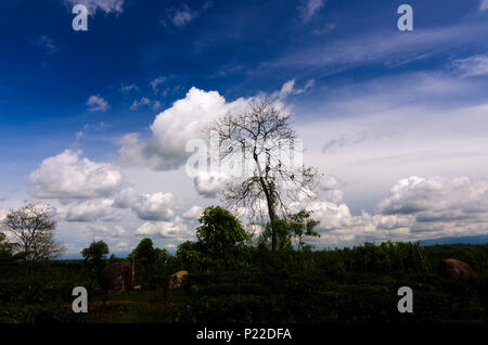 This is an image taken from a hill top on cloudy monsoon day with blue sky and clouds creating a canvas on the sky. - Stock Photo