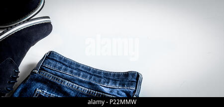 Set of mens clothing jeans, shoes,belt, on a white background - Stock Photo