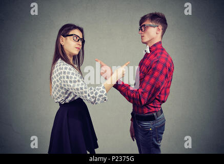 Annoyed angry man and woman facing relationships problems, pointing fingers each other blaming for mistakes. Couple in disagreement having argument, c - Stock Photo