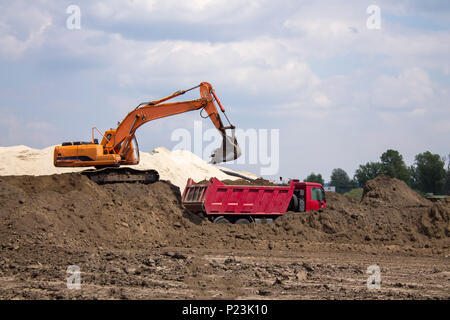 Photo of excavator and dumper truck. Construction site digger. Industrial machinery on building site. - Stock Photo