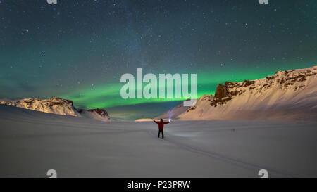 Northern lights over the mountains in Vik, Iceland - Stock Photo