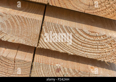Neatly stacked timber planks. Cross section of wood - Stock Photo