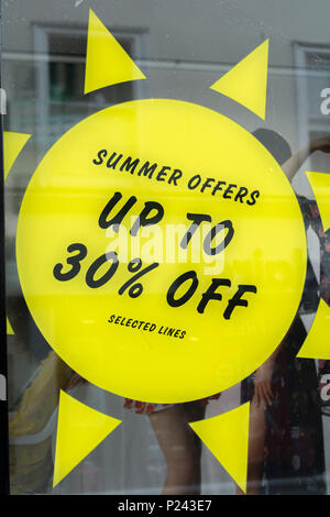 Summer sales sign in Truro (Cornwall) shop window. Metaphor high street squeeze, retail squeeze. - Stock Photo