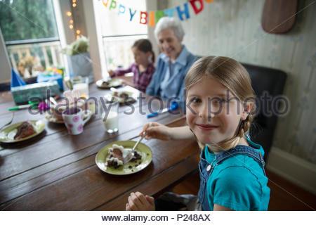 Portrait smiling granddaughter celebrating grandmother - Stock Photo