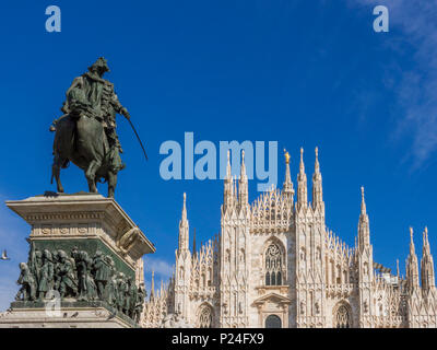 Equestrian statue of Vittorio Emanuele II with view to the Gothic cathedral at the Piazza del Duomo in Milan, Milano, Lombardy, Italy, Europe - Stock Photo