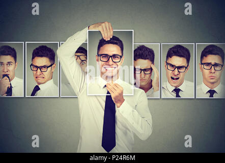 Masked man in glasses expressing different emotions - Stock Photo