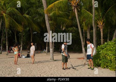 Singapore, Republic of Singapore, Visitors at Palawan Beach on Sentosa Island - Stock Photo