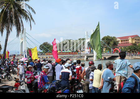 Phan Thiet , Vietnam - January 2014: Many people  during traditional dragon boat race during new year in Phan Thiet  , Vietnam - Stock Photo