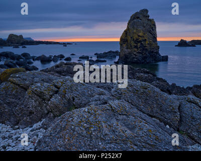 Northern Ireland, Antrim, Causeway Coast, bile formation in the Causeway Coast, evening sky - Stock Photo