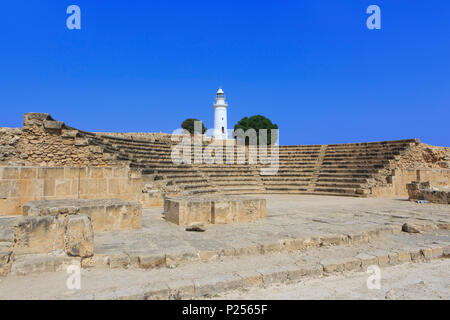 Odeon theater (2nd Century AD - 1200 seats) and lighthouse at the Paphos Archaeological Park in Paphos, Cyprus - Stock Photo