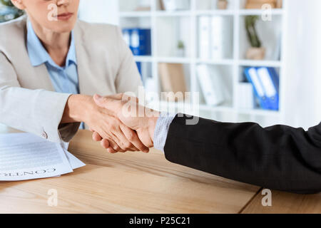 cropped shot of business colleagues shaking hands - Stock Photo